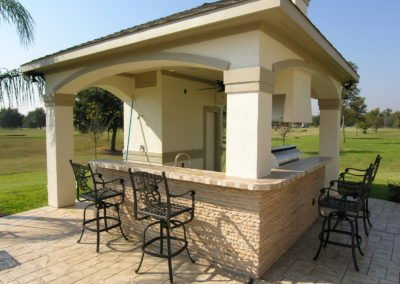 outdoor kitchen by the pool deck